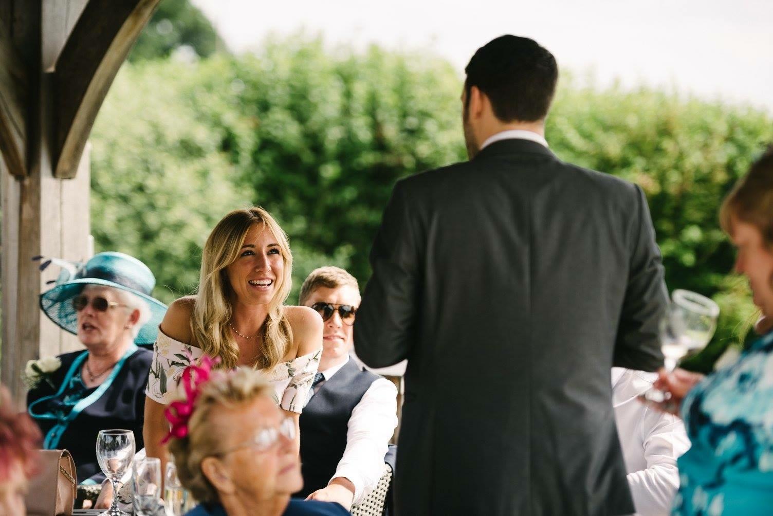 girl laughing with Aaron Calvert close up wedding magician