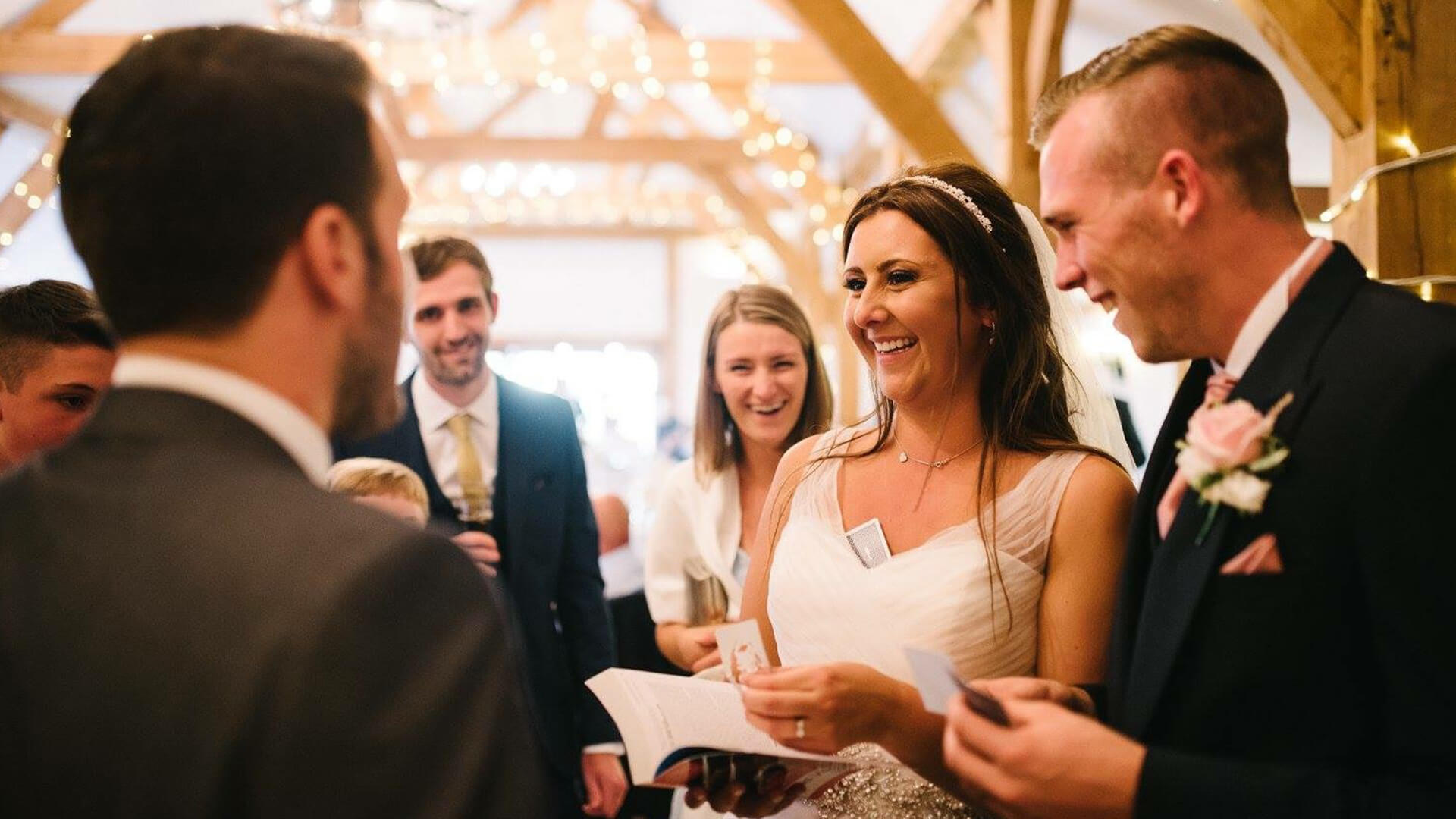 bride groom and friends having fun with Aaron Calvert manchester Wedding magician