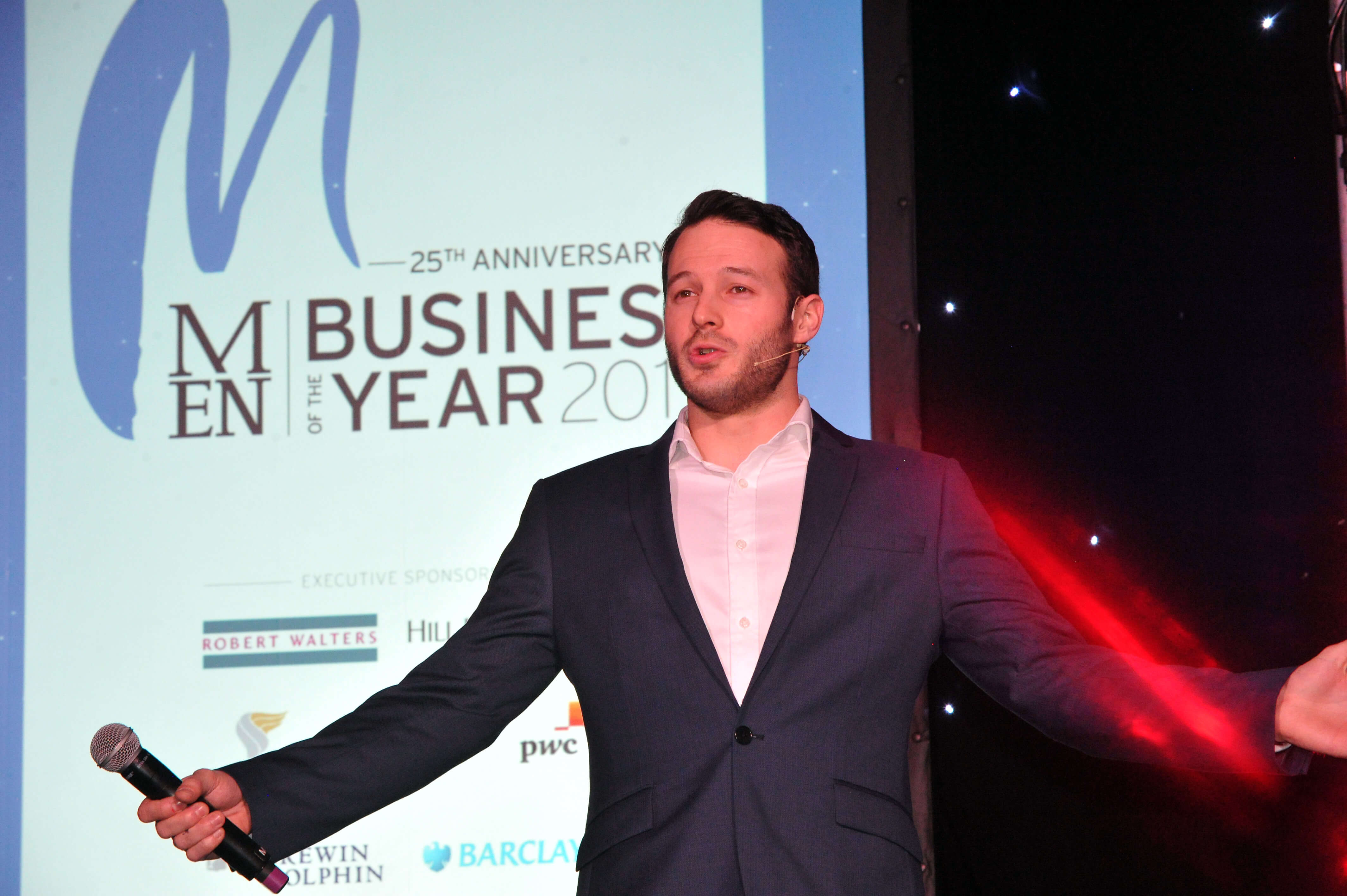 Manchester Corporate Entertainment Aaron Calvert on stage at Manchester Business Awards