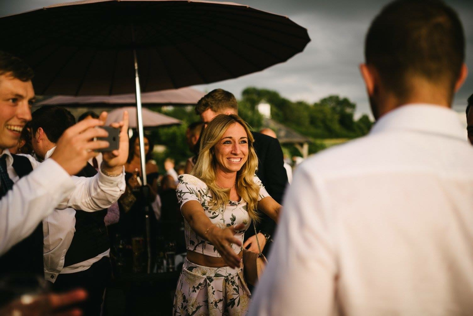 Manchester magician aaron calvert giggling with girl at manchester wedding