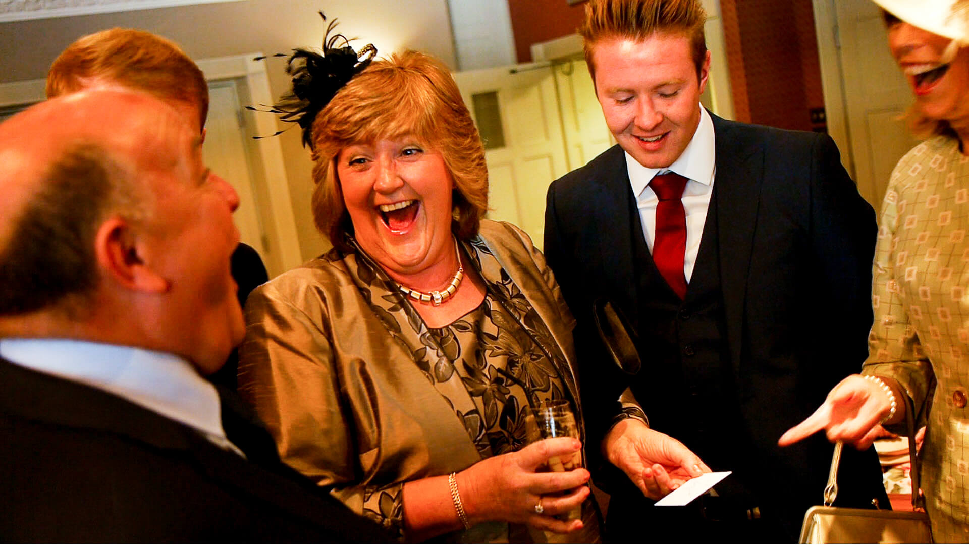 Manchester wedding magician performs magic for group of guests
