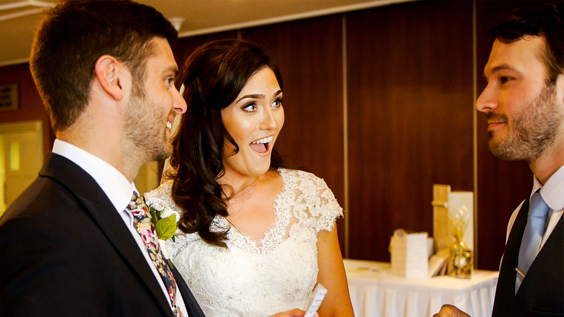Bride and groom with guests laughing and enjoying Manchester wedding magician aaron calvert performing mind reading and hypnosis