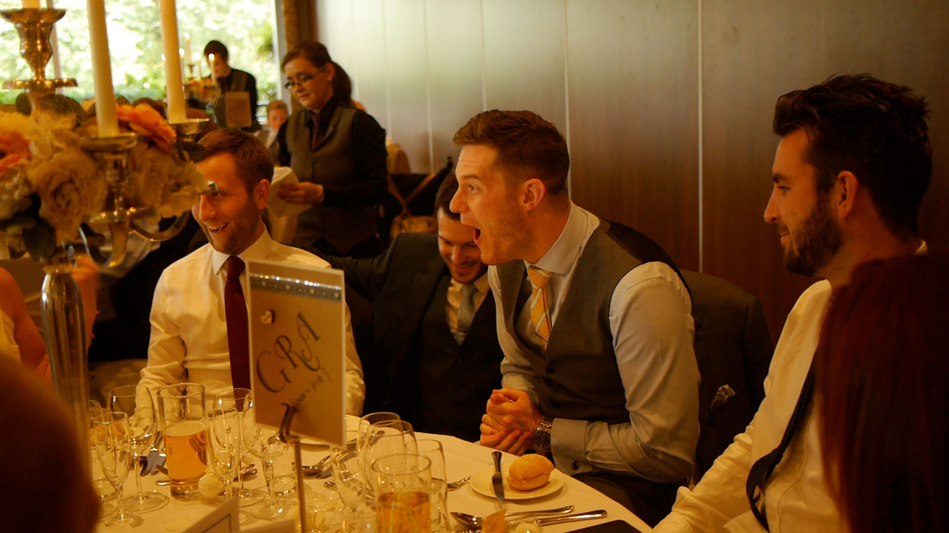 man screaming with disbelief as manchester wedding magician Aaron Calvert demonstrates incredible magic