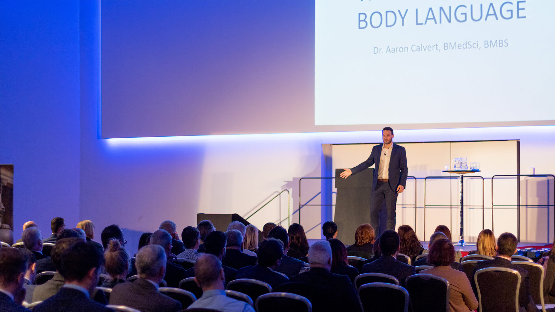Aaron Calvert keynote speaker talking about the psychology of business at manchester corporate entertainment event