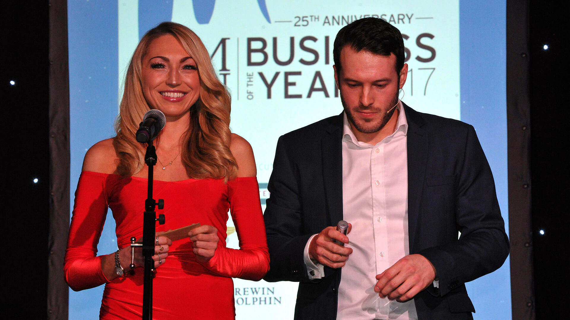 Aaron on stage at Manchester business awards providing corporate entertainment