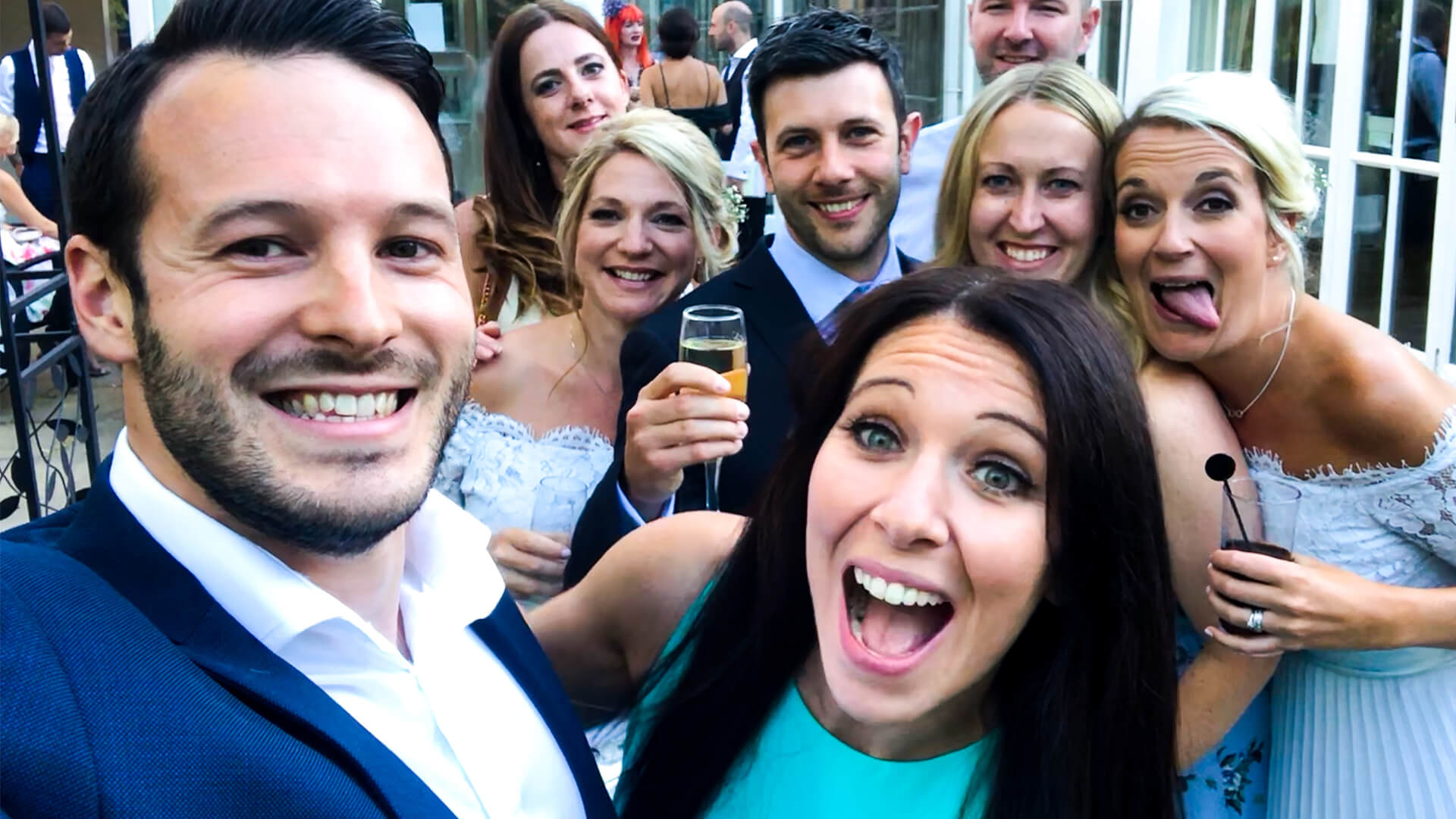 Aaron Calvert Manchester Wedding Magician taking selfie with guests during wedding entertainment