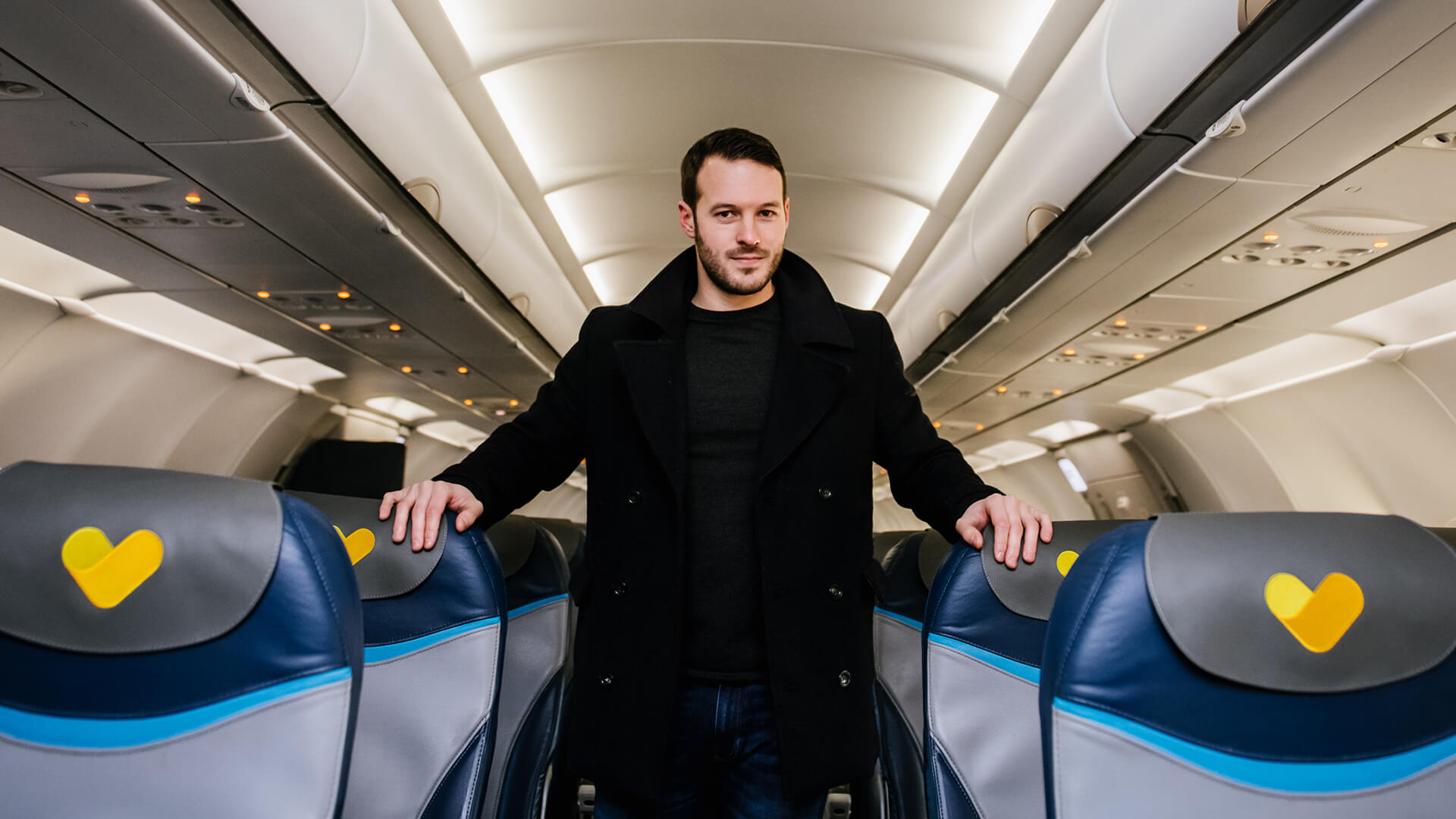 Mind reader and hypnotist Aaron Calvert on Thomas Cook Airlines plane for hypnosis experiment with first time fliers