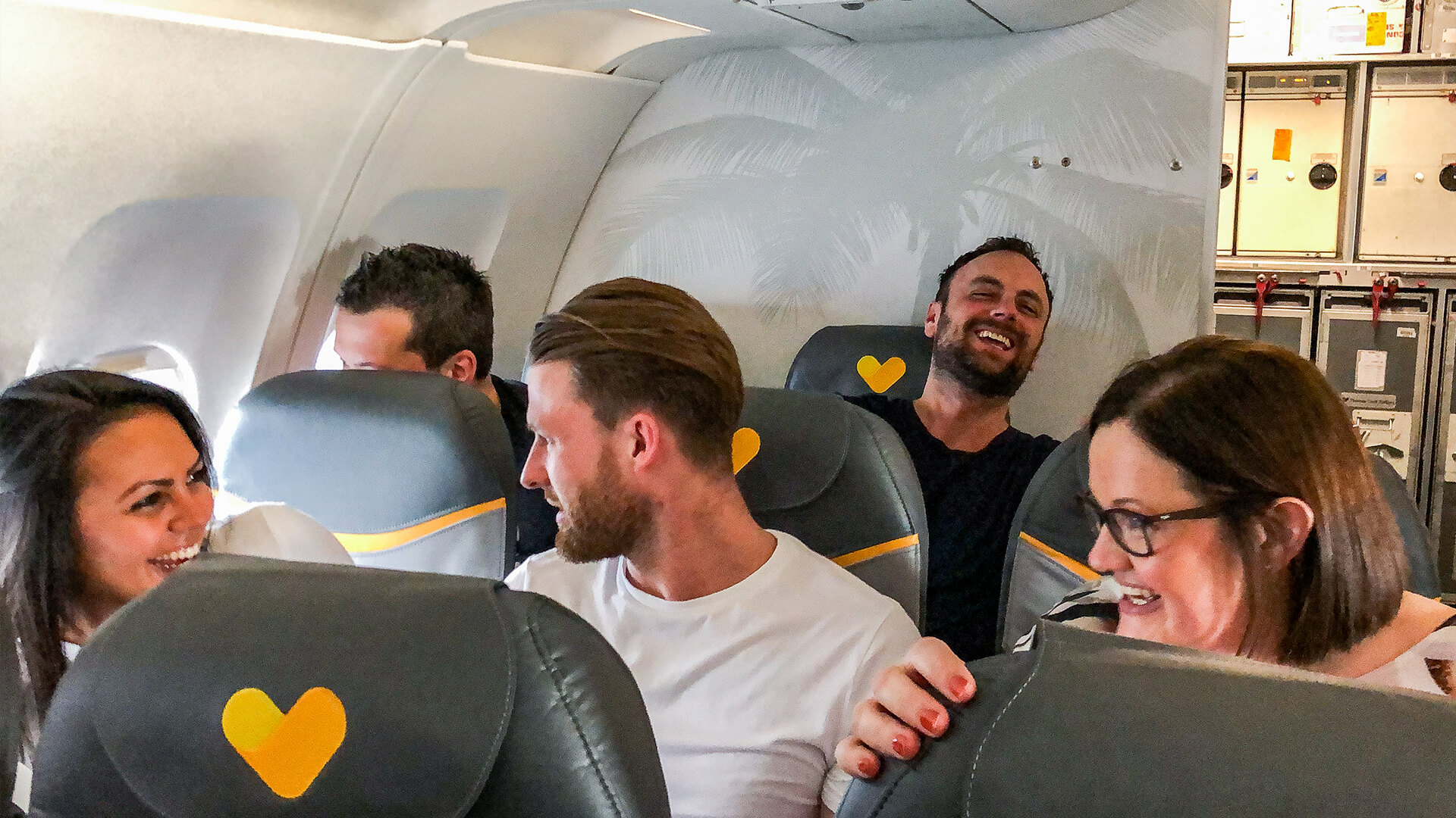 Group of Thomas Cook First Time Fliers enjoying their first flight hypnotised by aaron calvert