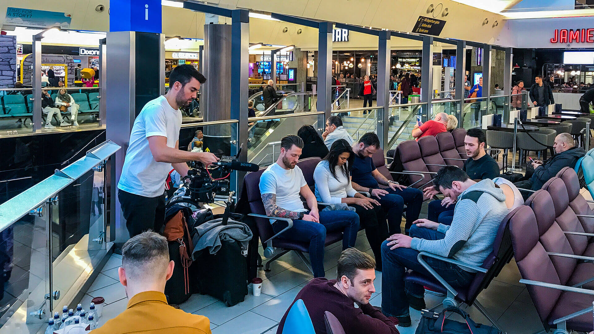 group of people being hypnotised for Thomas Cook Airlines and hypnotist Aaron Calvert First time flyer experiment
